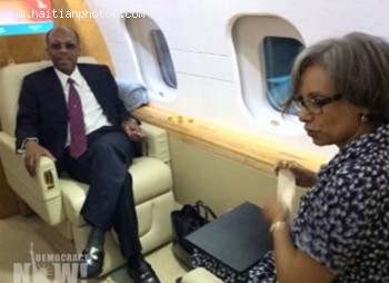 Jean-Bertrand Aristide And Midred Aristide In Airplane To Haiti