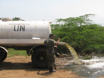 Picture Of A Tanker Truck Dumping Excrements Near Mirebalais Base
