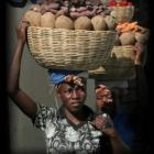 Woman Carring Food Products On Her Head